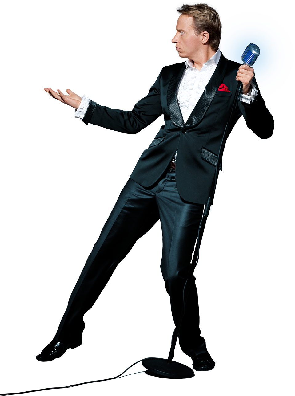 Komikern Håkan Berg gör en magisk handrörelse för att få en ros att sväva